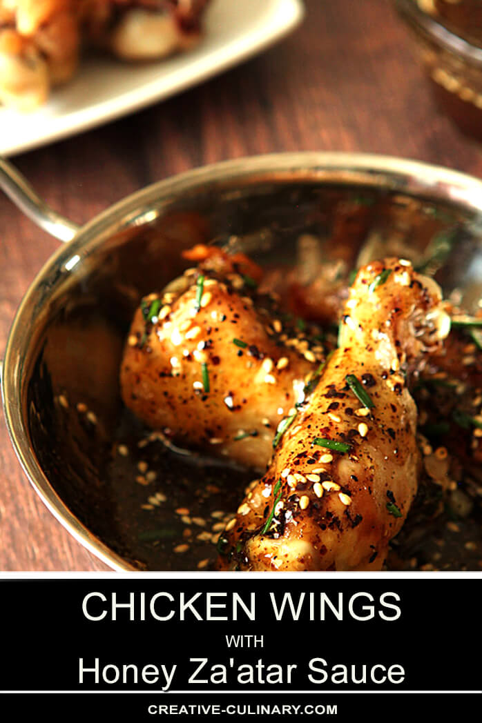 Chicken Wings with Honey and Za'atar Seasoning Served in a Metal Bowl