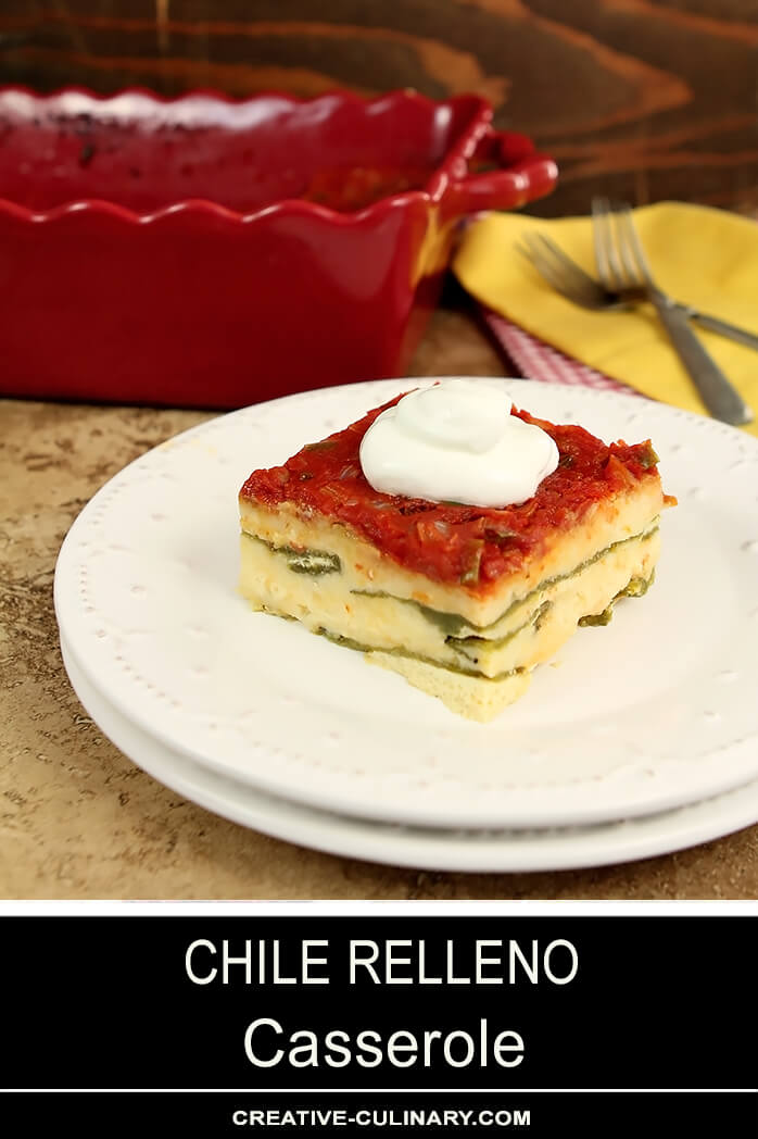 Chile Relleno Casserole Served on a White Plate with Sour Cream Garnish.