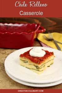 Chile Relleno Casserole Served on a White Plate, Garnished with Sour Cream.