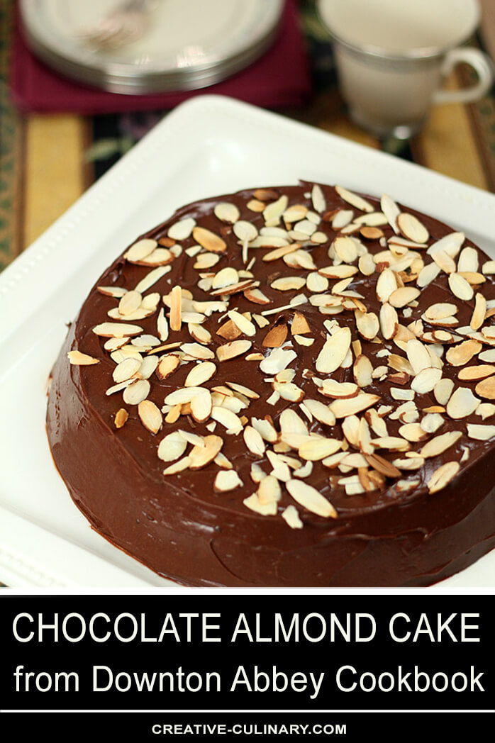 Chocolate Almond Cake with Sour Cream Frosting on a White Square Cake Plate