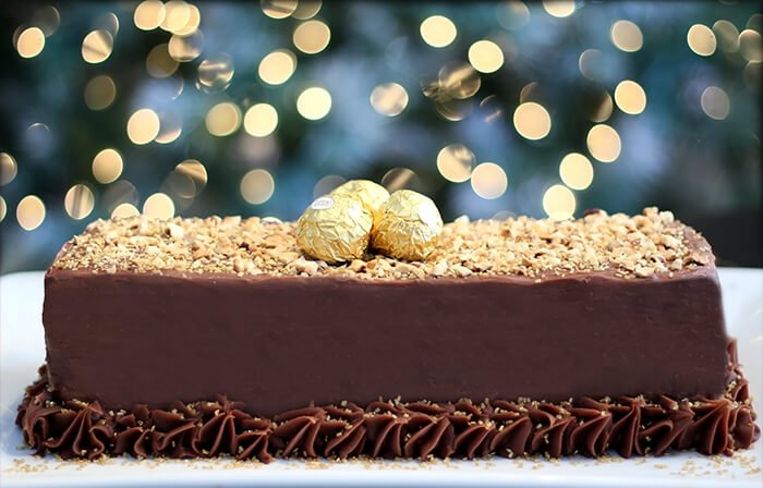 Chocolate Meringue Cake with Ferrero Roche on Top Sitting on a Tabletop