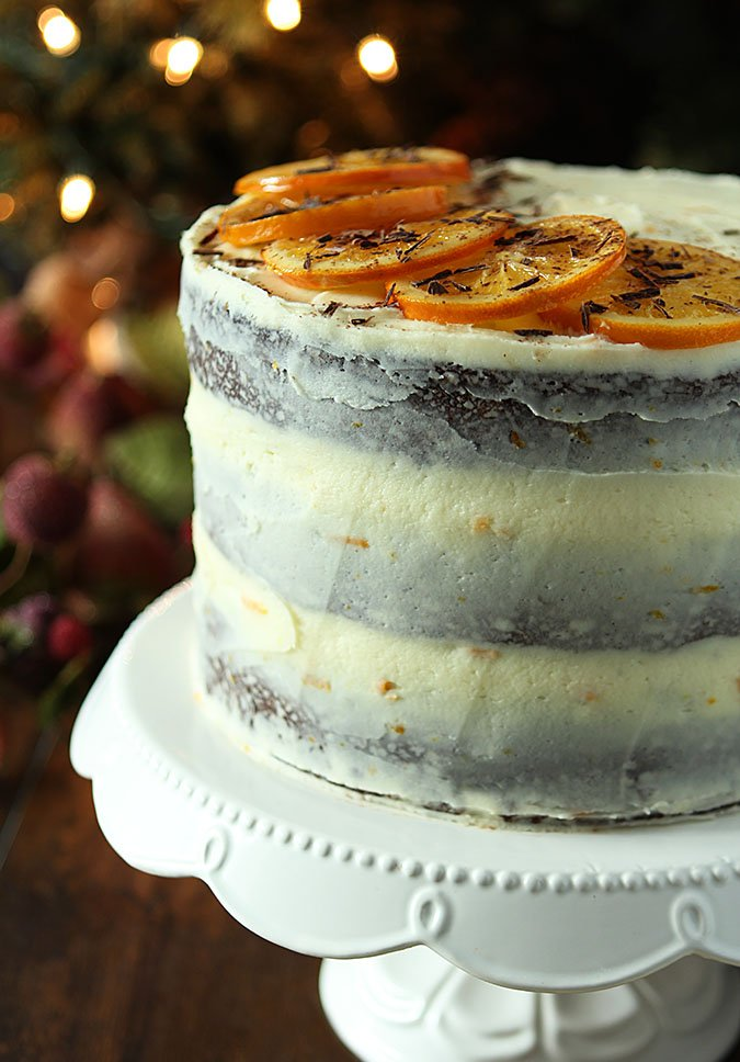 Orange Slices and Grated Chocolate Decorate the top of an Orange Stout Chocolate Cake with Buttercream Frosting