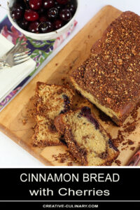 Cinnamon Bread with Cherries on a Bread Board