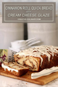 Loaf of Cinnamon Roll Quick Bread with Cream Cheese Glaze with Slices