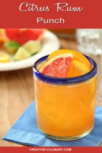 Glass of Citrus Rum Punch Garnished with Grapefruit and Orange Slices