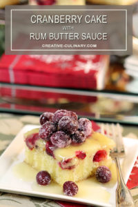 Cranberry Cake with Rum Butter Sauce Served with Sugared Cranberries on Top