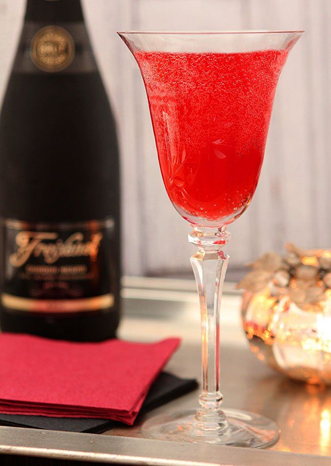 Cranberry Liqueur Champagne Cocktail in a Wine Glass