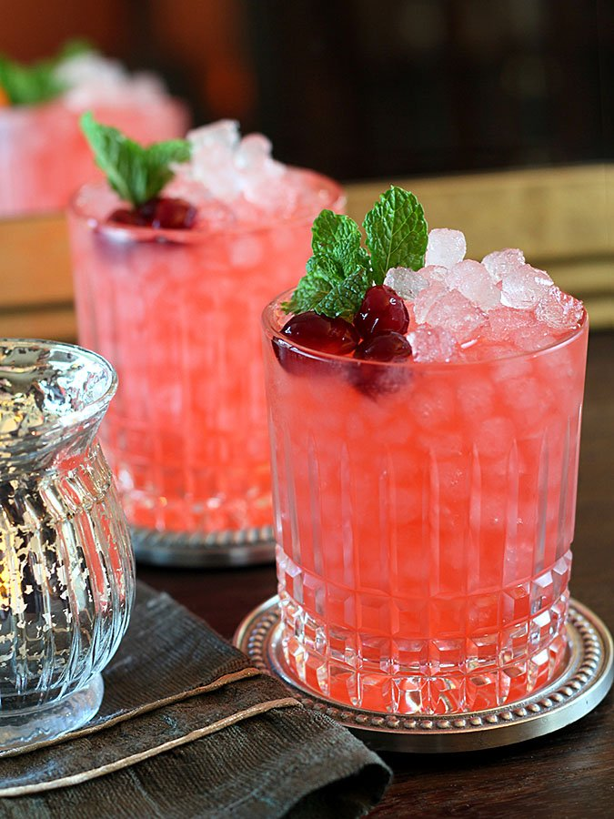 Cranberry Ginger Fizz Cocktails Garnished with Cranberries and Mint