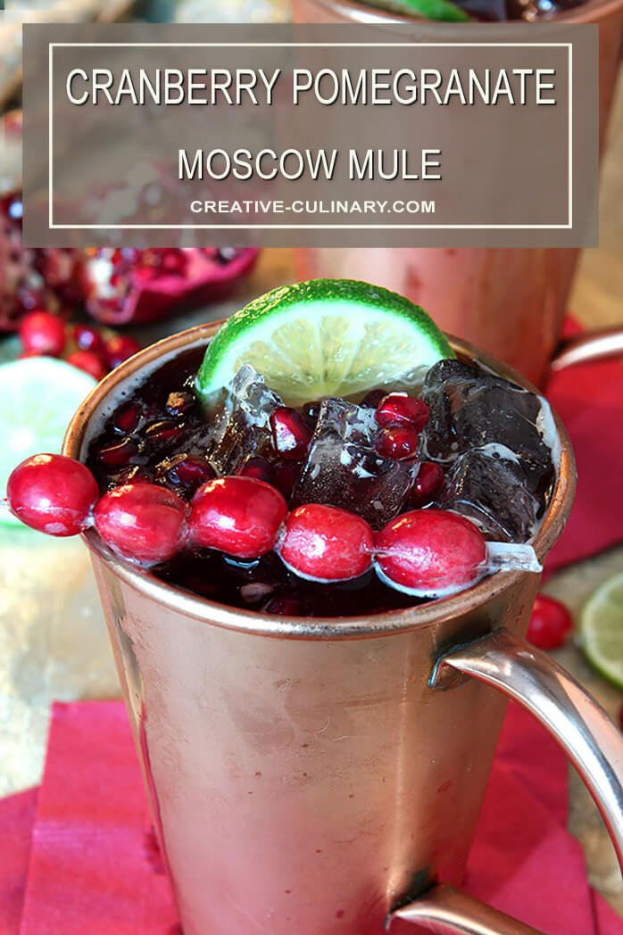 Cranberry Pomegranate Moscow Mule Garnished with Cranberries and a Lime Wedge