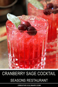 Cranberry Sage Cocktail with Cranberries and Sage Leaf Garnish