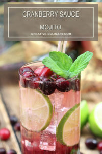 Cranberry Sauce Mojito Cocktails Garnished with Cranberries and Mint