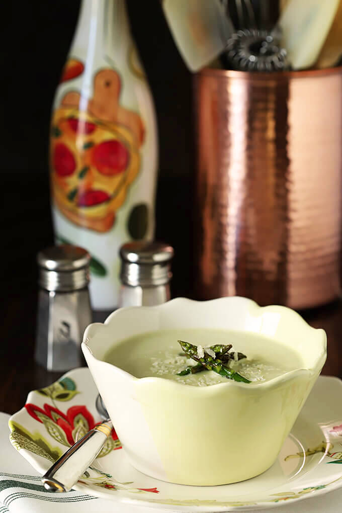 Cream of Roasted Asparagus Soup with Garlic & Parmesan in a Yellow and White Bowl