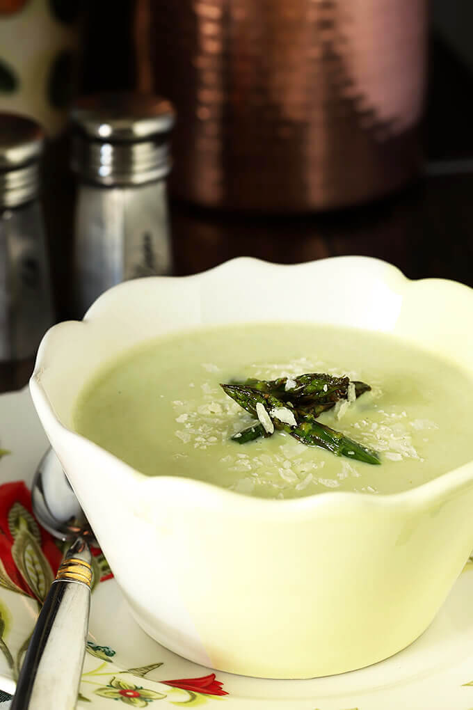 Cream of Roasted Asparagus Soup with Garlic & Parmesan in a White and Yellow Bowl