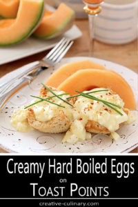 Creamy Hard Boiled Eggs on Toast Points Served with Cantelope and Garnished with Chives and Paprika