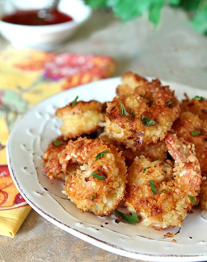 Crispy Coconut Shrimp Appetizer Served on a White Plate and Garnished with Parsley