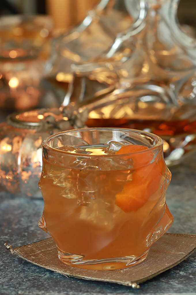 Bourbon and Fig Cocktail with Orange Liqueur Served in a Glass with an Orange Twist