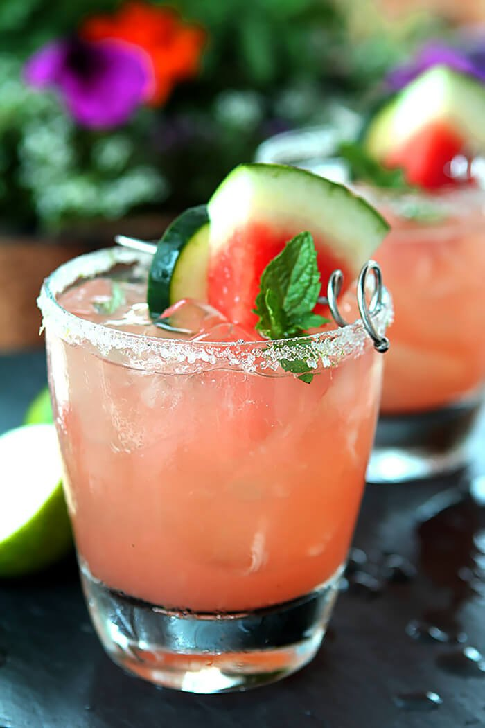 Watermelon, Cucumber, and Lime Cocktail Garnished with Watermelon, Cucumber and Mint
