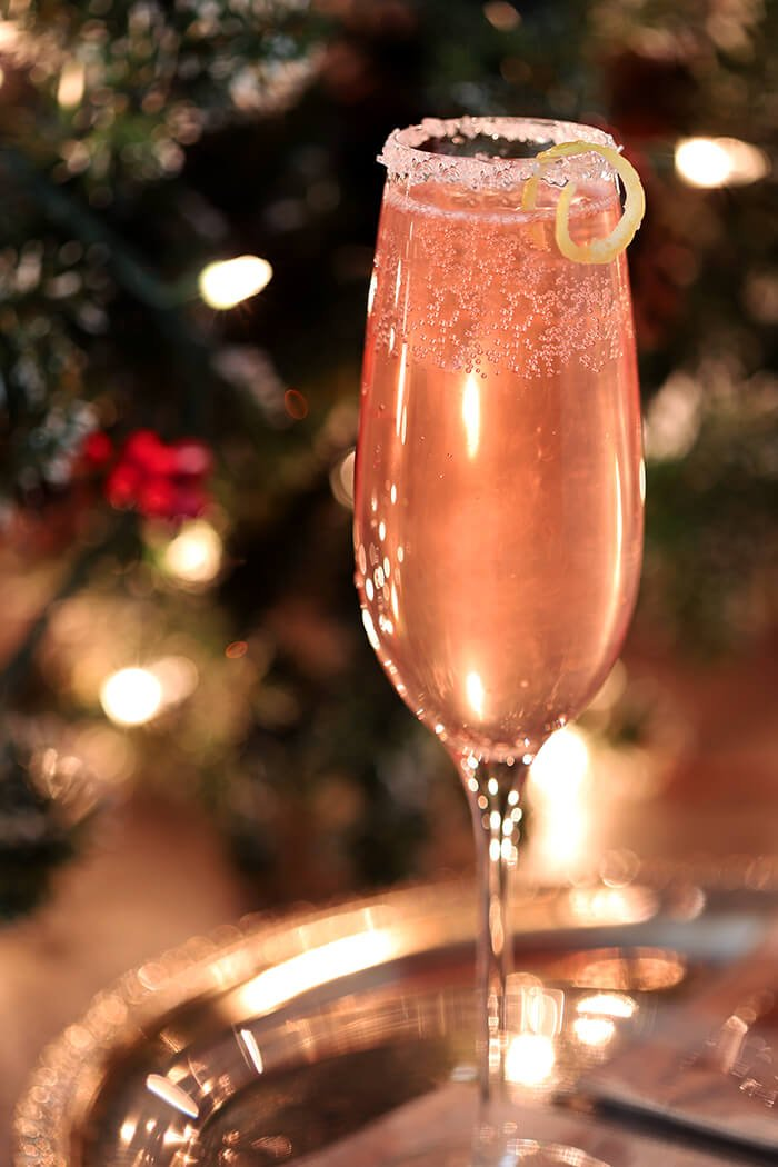 French 77 Pink Champagne Cocktail Garnished with Lemon Peel