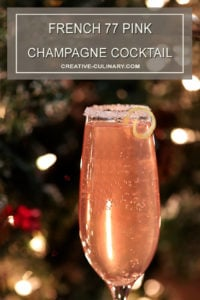 French 77 Pink Champagne Cocktail Garnished with a Sugar Rim and Lemon Peel