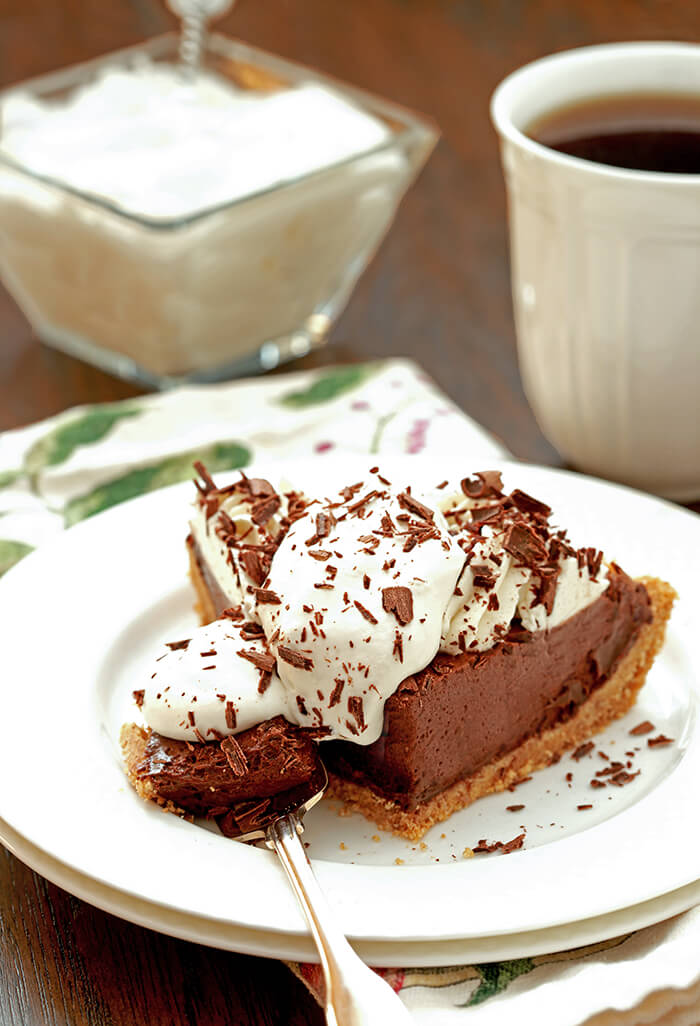 French Silk Pie with Bourbon with extra whipped cream and chocolate curls.