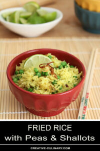 Crispy Shallots Fried Rice in Wok in Red Bowl with Lime Garnish