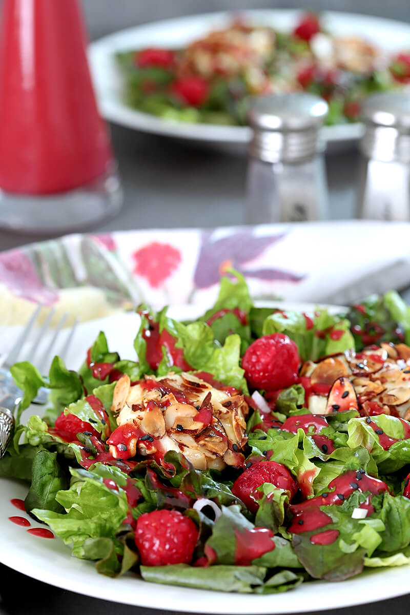 Goat Cheese and Raspberry Salad on a White Plate with Raspberry Dressing