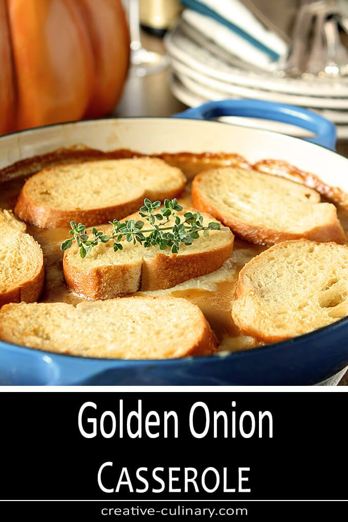 Golden Onion Casserole with Thyme and Toasted Bread Rounds in a Blue Serving Dish