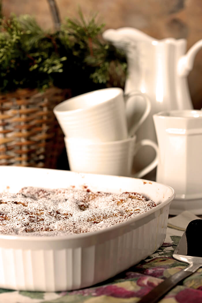 Gooey Butter Cake Overnight French Toast Served in a White Porcelain Baking Dish