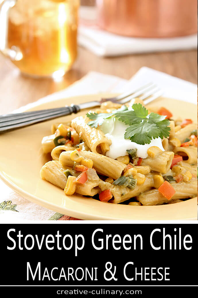 Stovetop Green Chile Macaroni and Cheese Served with a Dollop of Sour Cream on a Yellow Plate