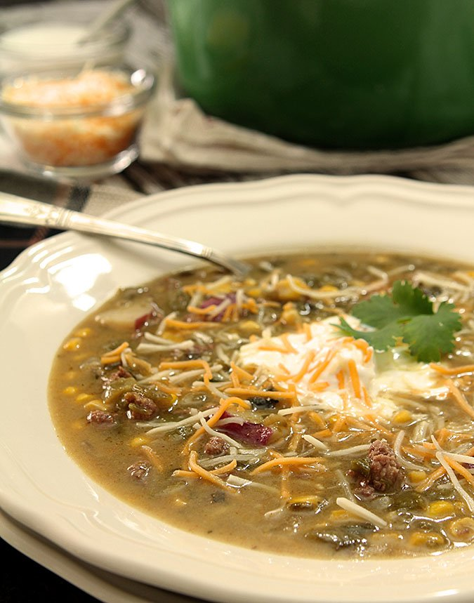 American Indian Green Chile Stew Served in a Wide Bowl with Sour Cream Garnish