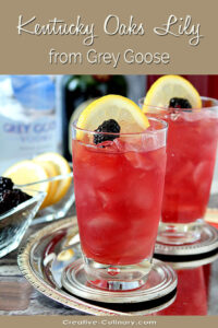 Two Glasses of a Kentucky Oaks Lily Garnished with Lemon Slice and Blackberry