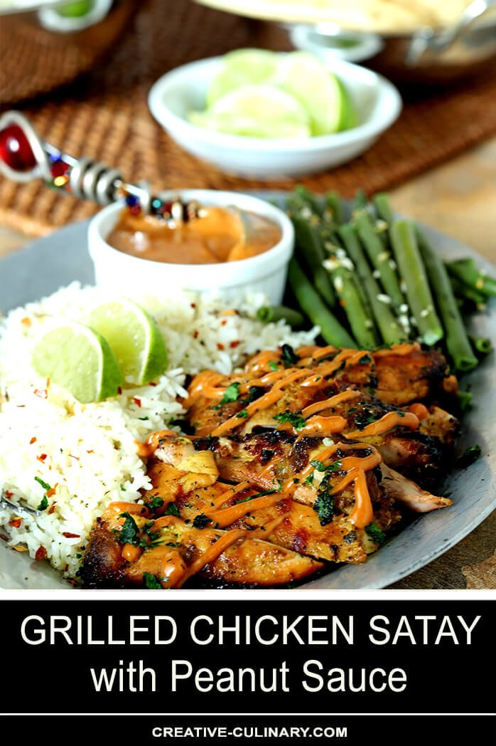 Grilled Chicken Satay with Peanut Sauce on Plate with Green Beans and Rice