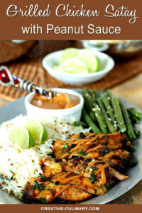 Grilled Chicken Thighs with Peanut Sauce on Plate with Green Beans and Rice