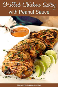 Grilled Chicken Thighs with Peanut Sauce on Serving Plate with Lime Wedges
