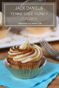 Closeup of Jack Daniels Honey Whiskey Cupcakes with a Boozy Drizzle from a Spoon