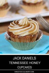 Closeup of Jack Daniels Honey Whiskey Cupcakes with a Boozy Drizzle from a Spoon In a Metallic Cupcake Liner