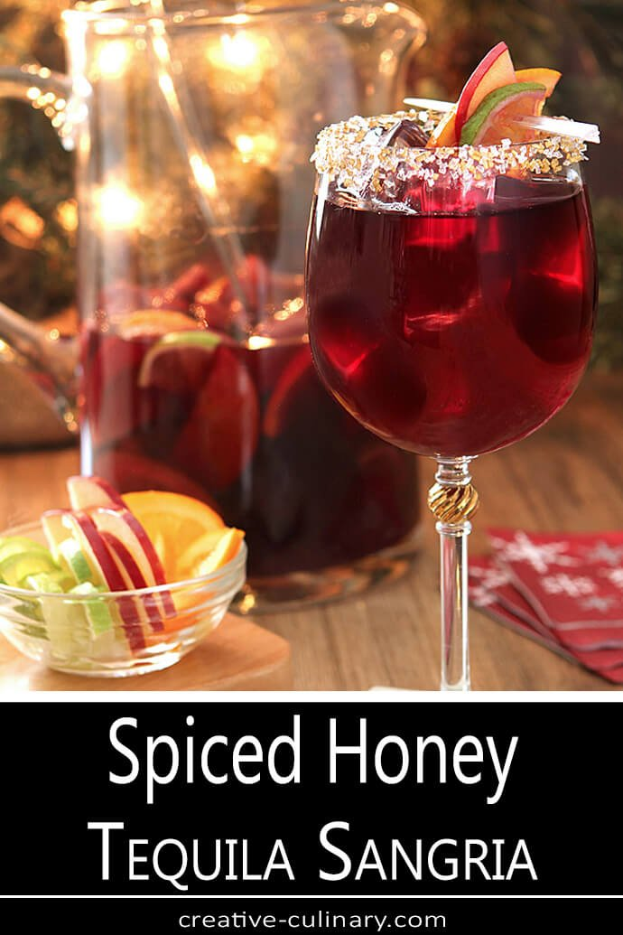 Spiced Honey Tequila Sangria Served in Wine Glasses with Cake Decorating Sugar on Rims Served in Wine Glasses with Sugared Rims