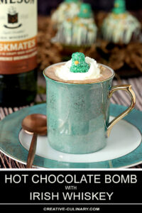 Prepared Hot Chocolate Bomb in Green Cup with Whipped Cream and Green Marshmallow Hat for Garnish
