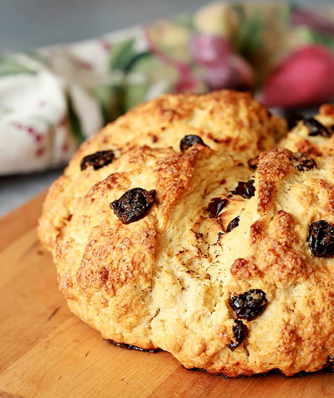 Irish Soda Bread with Tart Cherries Served on a Cutting Board