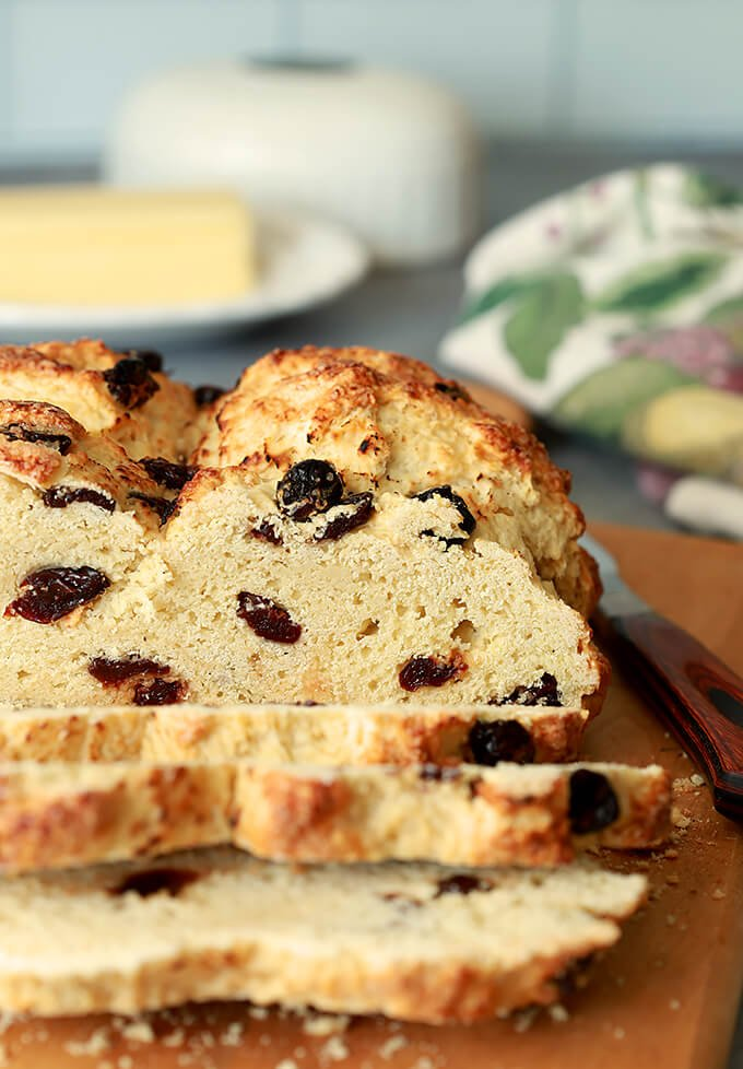 Irish Soda Bread with Tart Cherries Sliced on Bread Board