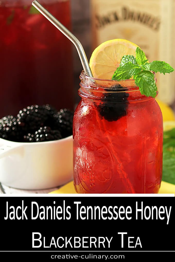 Jack Daniels Tennessee Honey Blackberry Tea in a Mason Jar with Lemon and Mint