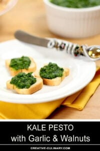 Kale Pesto Appetizer on Melba Toast Served on White Plate