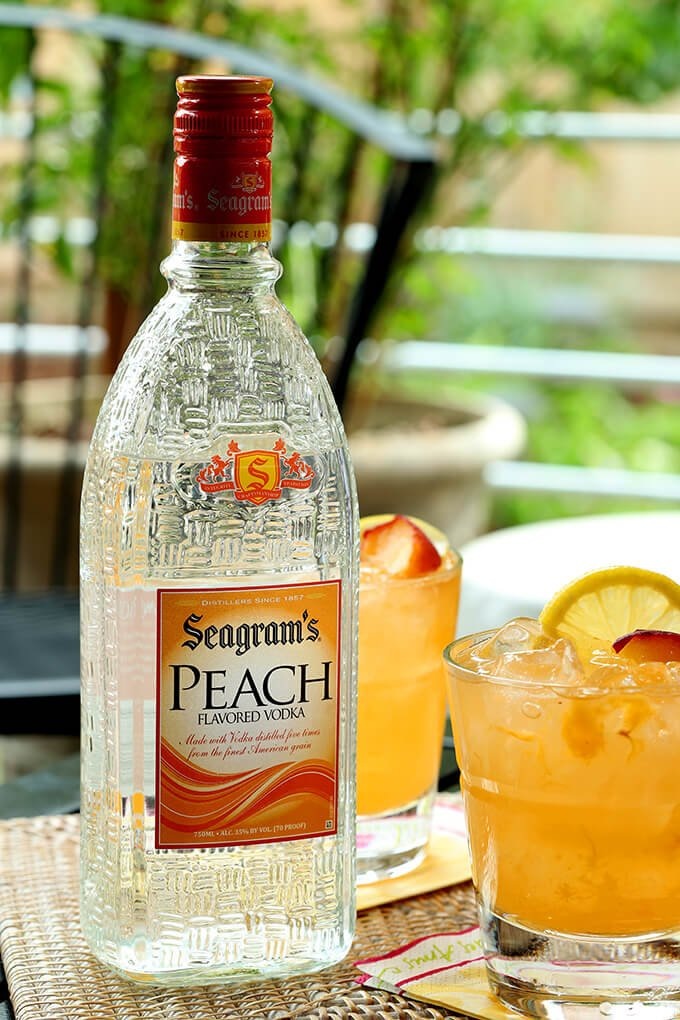 Kentucky Peach Bourbon and Vodka Cocktail and a Bottle of Seagram's Peach Vodka