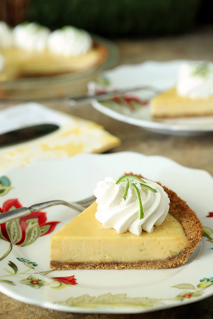 Key Lime Pie with Whipped Cream and Lime Zest Slice Served on a Plate