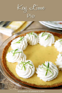 Key Lime Pie with Whipped Cream Garnished with Lime Zest