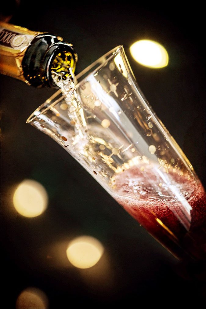 Kir Royale Champagne Cocktail Showing Champagne Pouring into Glass with Creme de Cassis