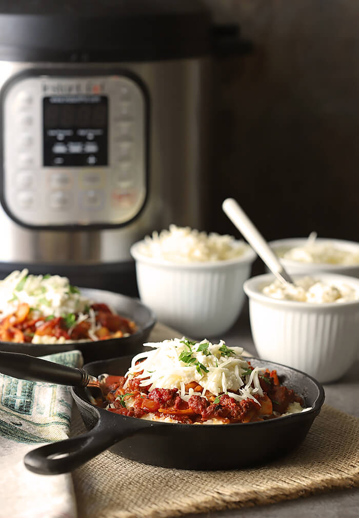 Quick Cheesy Lasagna in Instant Pot Shown with Appliance and Three Cheeses