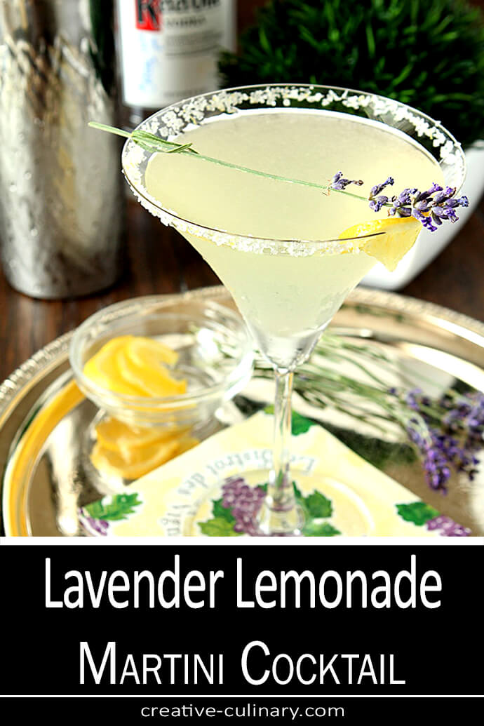 Lavender Lemonade Martini Cocktail in a Glass Rimmed with Sugar and Garnished with Lemon and Lavender