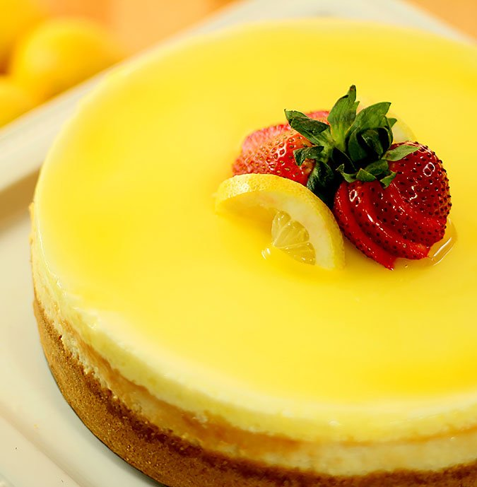 Luscious Lemon Cheesecake with Strawberry and Lemon Slice Garnish