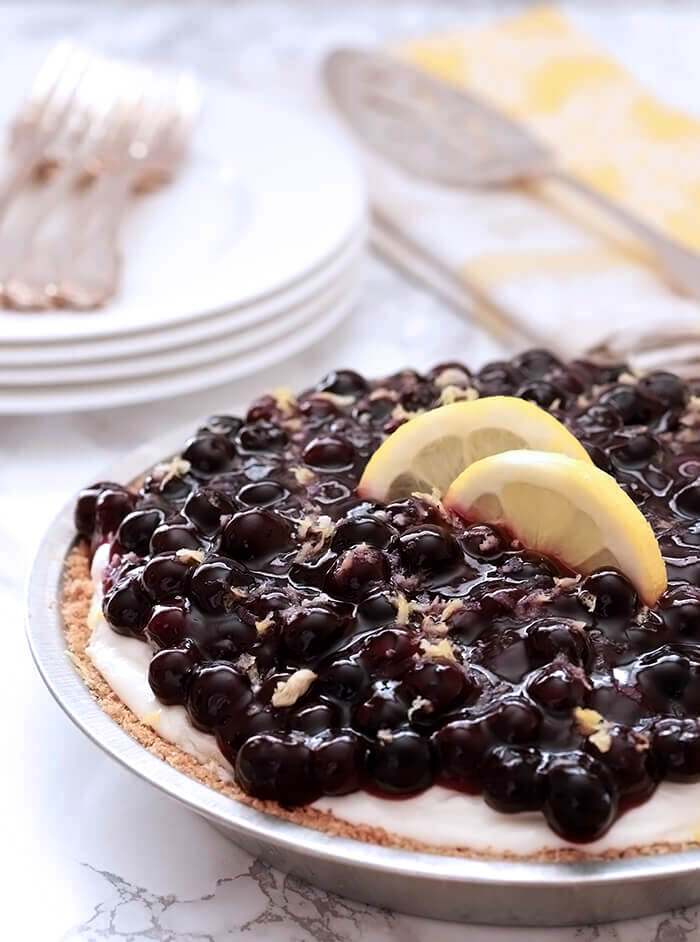 Lemon Cream Pie with Blueberries Whole with Lemon Slices for Garnish